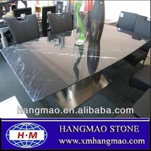 Polished black marble dining table