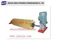 Motorize brush belt cleaner for mechanical joint coveyor belt