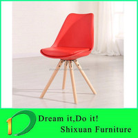 red coffee hand shaped wood chair