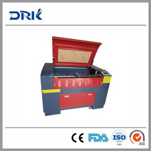 Good quality CO2 laser red dot & auto focus personal laser cutter DRK1390