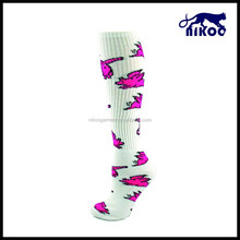flying pigs print all over on the calf sport socks with florescent pink