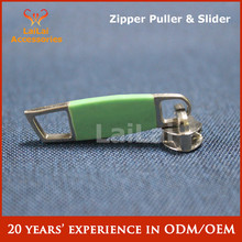 Zipper slider and puller
