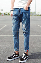 Hot sale men 's skull pattern patch pencil pants of tops and jeans photos