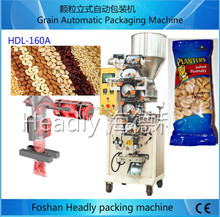 chinese foshan nanhai Headly automatic weighing small scale food nuts peanut filling and packing machine packing price