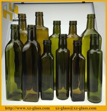 Dark green olive oil bottle