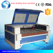 China fabric laser cutting machine for leather cloth 1610 1620 auto feeding laser cutting machine for sale