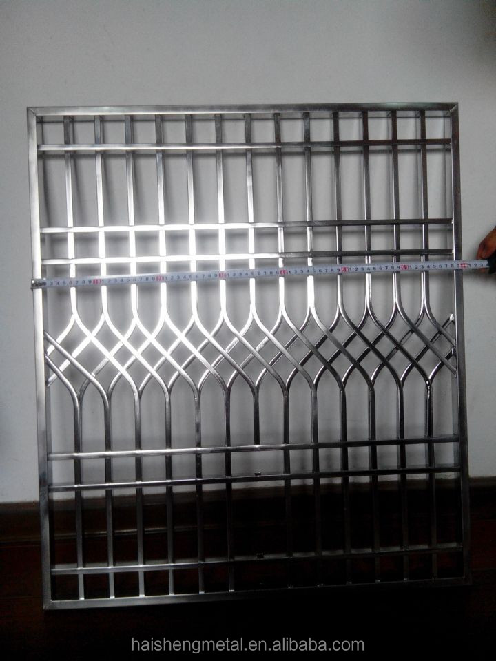 Steel door grills design pictures modern house for Modern house grill design