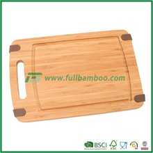 Square bamboo cutting board with a handle and a groove