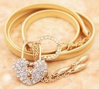2015 Fashion Luxury heart lock crystal gold buckle belt metal elastic chain tassel belt female skirt waist belt for women