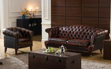 Oxblood sofá de cuero