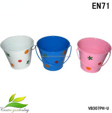 Hand paniting zinc garden seed planters and pails