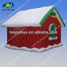 red inflatable santa grotto house