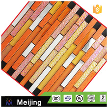 Foshionable hot melt golden glass mosaic for interior wall panels alibaba website