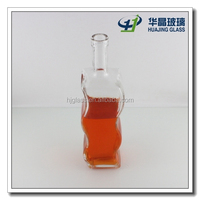 High quality 750ml bulk curved side s -shape glass liquor bottle with stopper wholesale