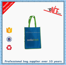 firm nonwoven shopping handbag with X stitching at top edge