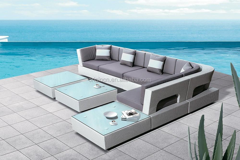 Esquina exterior elegante sofá con otomana y tapa de cristal mesa de ...