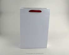 High quality Embossing fancy paper LOGO hodfoil stamped Luxury shopping paper bag with white