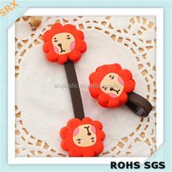 OEM Fashion lion shape earphone soft plastic holder