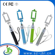 Free sample cheap selfie stick mobile phone with wireless bluetooth