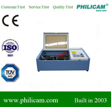 the big discount stamp engraving machine/mini co2 laser machine for hot sale