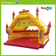 yellow giant inflatable bouncy jumping castle with slide