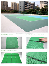 Portable interlocking plastic floor for volleyball court