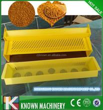 Plastic yellow internal pollen trap for european beekeeping