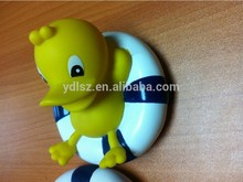Flashing plastic duck with electronic singing