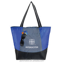 210 denier polyester Tote Style Cooler Bag Has a silver PEVA lining and foam insulator and a zipper front pocket