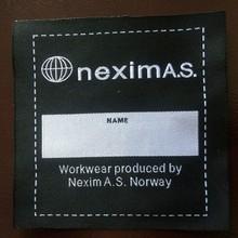 fire retardant woven label for fire retardant sheeting