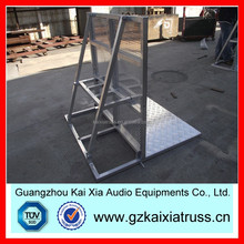 Folding safety barrier for stage
