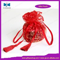 red organza circle bag with tassel drawstring