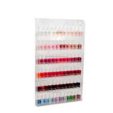 Display stand with acrylic shelf pusher for nail polish retail