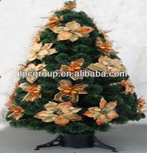 Green christmas tree with flowers and ornament