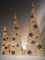 Folding Christmas sisal tree with star on surface w/lights