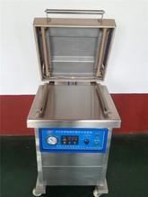 Vacuum sealer for food packaging line