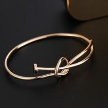 Alibaba website steel nail knot bracelets 18k gold magnetic copper new simple fashion design bangles for girls