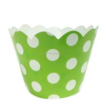 Puntos blancos en partido verde papel envoltura de la magdalena