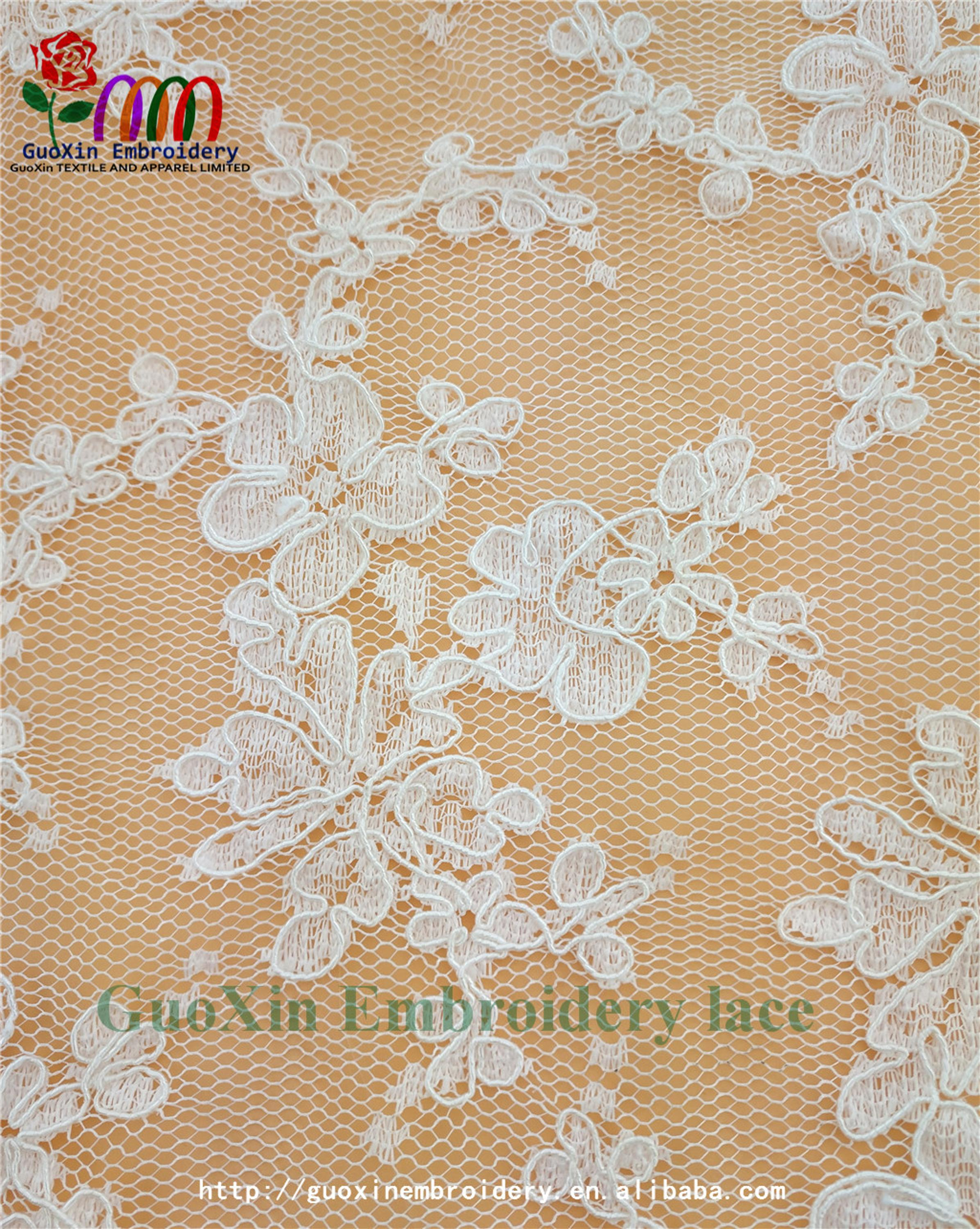 factory wholesale ivory embroidered french lace fabric with cording (3).jpg