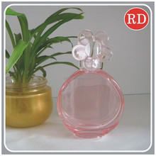 transparent perfume bottle with flower cap