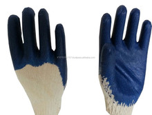 NITRILE COATED GLOVES ON NATURAL COTTON 100 % .