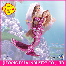 Pretty Mermaid mother and mermaid little girl with accessories