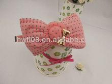 Polka dot fabric hair band with metal bowknot