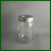 16oz round glass mason jar with silver daisy cut lid