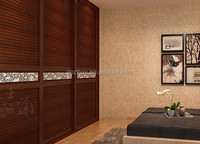 louvered solid wooden sliding closet doors