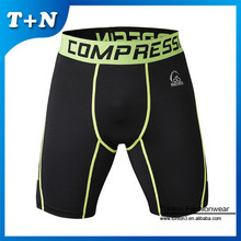 Gros oem digital printing fitness compression shorts de course / yoga pantalons