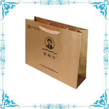 golden textured paper bag with logo UV spot
