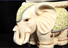 Elephant shaped silver leather ottomans