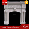 white indoor marble fireplace