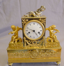 brass clock with two angels